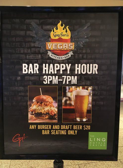 Guy Fieris Vegas Kitchen & Barのハッピーアワーの看板